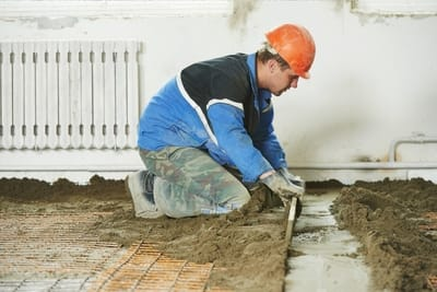 concreter adding concrete on the floor | Mackay Concreters